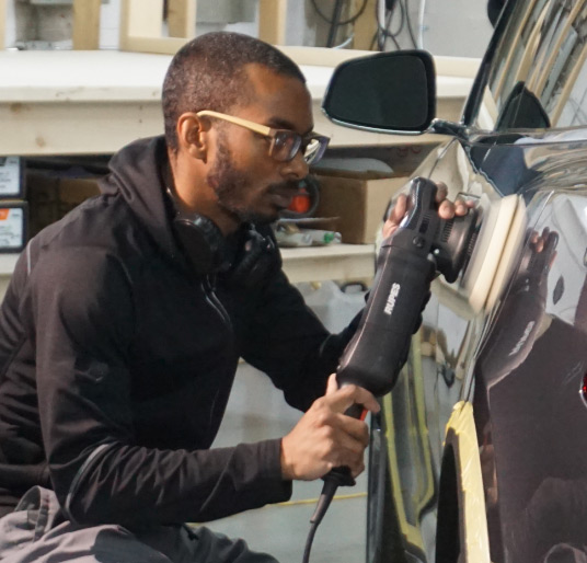 Fabian Evelyn Polishing a car